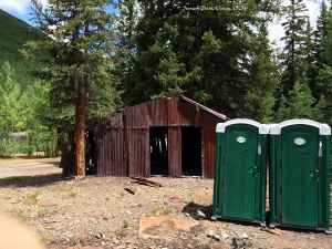 "Porta-potties and ramshackle building, ""North Field"", Ironton Park."